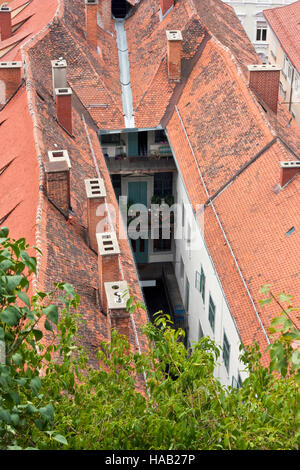 Old house with tiled roof and narrow inner courtyard in the City Graz, Styria Austria Europe - Stock Photo
