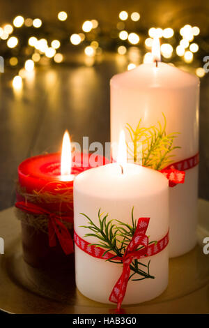 Red Christmas candle and Christmas light on wood - Stock Photo