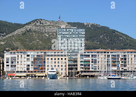 Modernist Town Hall & Seafront Buildings of Toulon Port or Harbour with Mount Faron as a Backdrop - Stock Photo