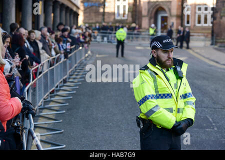 Chester, UK. 28th November 2016. People wait outside Chester Cathedral to watch guests arrive for the memorial service - Stock Photo