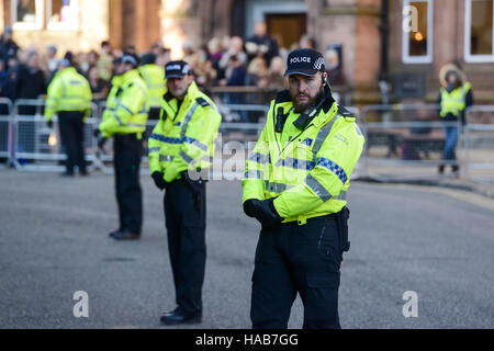 Chester, UK. 28th November 2016. A strong police presence outside Chester Cathedral as guests arrive for the memorial - Stock Photo