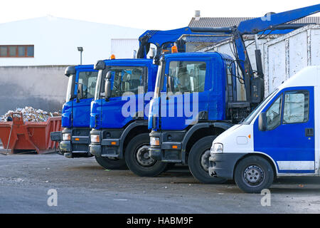 Few garbage trucks on the parking lot. - Stock Photo