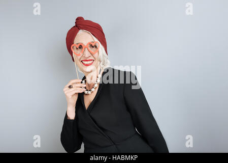 : Senior smiling woman having fun. - Stock Photo