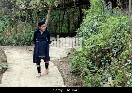 Black Hmong woman in Xin Chai village, Lao Chai, Sapa, Vietnam, Asia - Stock Photo