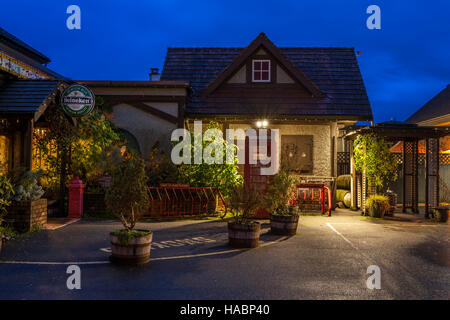 Six Mile Pub and old style British telephone booth at twilight-View Royal, Victoria, British Columbia, Canada. - Stock Photo