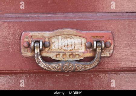 Ornate brass door knocker on door in Bolivia - Stock Photo