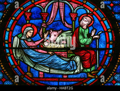 Stained Glass window in the Cathedral of Bayeux, France, depicting a Nativity Scene at Christmas. - Stock Photo