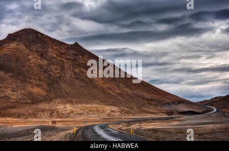 The Ring Road in Iceland cuts through the Mountains of the Highlands on a Stormy Autumn Day - Stock Photo