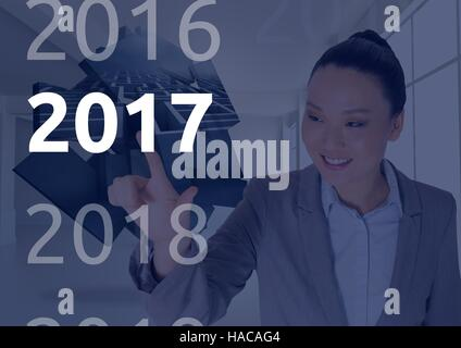 Business woman in digitally generated background touching 2017 - Stock Photo