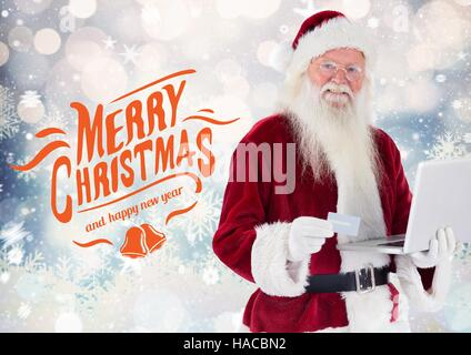 Happy santa claus doing online shopping from laptop - Stock Photo