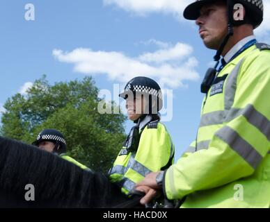 Mounted police patrol the Horse Guards Parade, London, England - Stock Photo