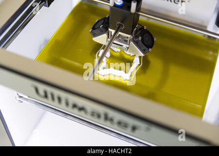 An 'Ultimaker 2' 3D printer, in use printing a cookie cutter - Stock Photo