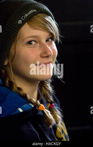 Young girl looking at camera smiling. - Stock Photo
