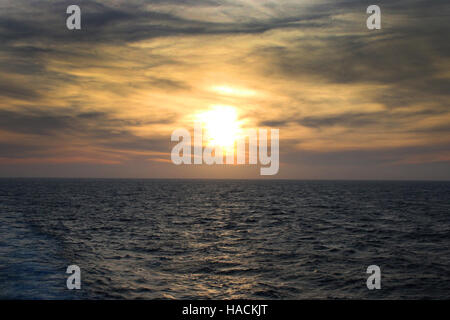 Sunset over the Ocean, off the coast of the Azores, Atlantic Ocean. - Stock Photo