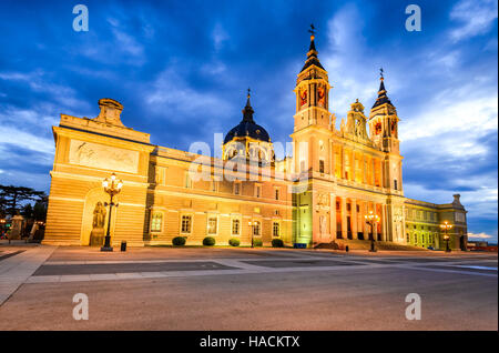 Madrid, Spain. Twilight skyline of Santa Maria la Real de La Almudena Cathedral, seat of the Roman Catholic Archdiocese - Stock Photo