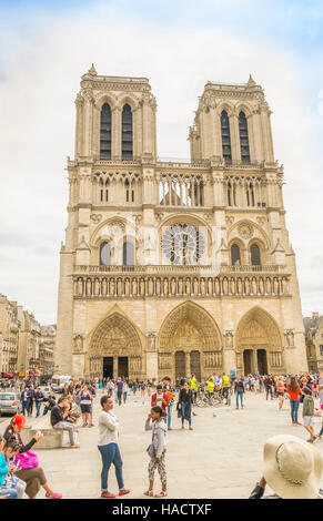 tourists in front of notre dame cathedral - Stock Photo