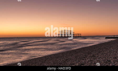 Brighton's burnt out West Pier at sunset UK - Stock Photo