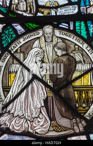 England, London, Wapping, St Peter's London Docks Anglican church, Stained Glass Window depicting Marriage Ceremony - Stock Photo