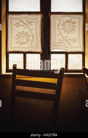 Closeup View Of An Old Wooden Window And Chair In Front It