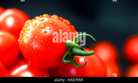Tomatoes. Cherry tomatoes. Cocktail tomatoes. Fresh grape tomato on black background - Stock Photo