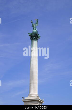 The column of the Millenary Monument, with Archangel Gabriel and Vajk (King Stephen) on top, Heroes Square, Budapest, - Stock Photo