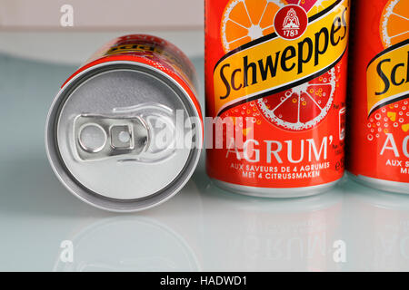 Small cans of soda Schweppes - Stock Photo