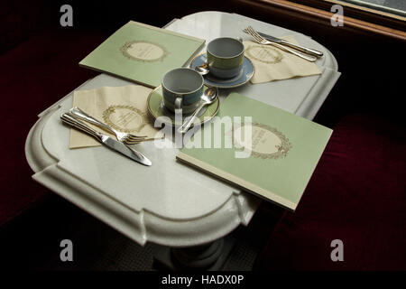 A table at Ladurée patisserie and tea room, Rue Bonaparte, Paris, France - Stock Photo