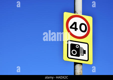 Speed limit sign on the beautiful blue sky - Stock Photo