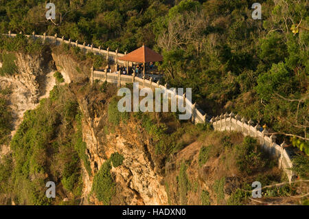 Cliffs next to the Ulu Watu temple Pura Luhur. Bali. Uluwatu Temple is a Hindu temple set on the cliff bank in south - Stock Photo