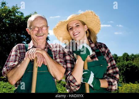 Male and female gardener - Stock Photo