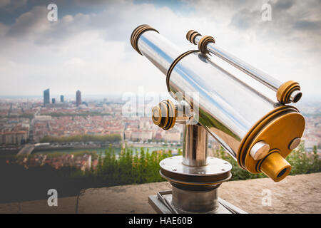 Telescope directed towards the city of Lyon in France - Stock Photo