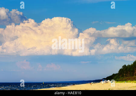 Cloudscape with huge cumulonimbus cloud formation over the beach at Baltic sea. Stegna, Pomerania, northern Poland. - Stock Photo