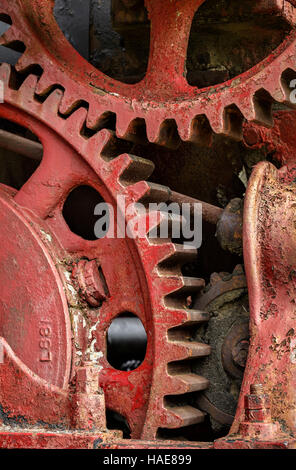 Gears from an antique threshing machine, close up view. - Stock Photo