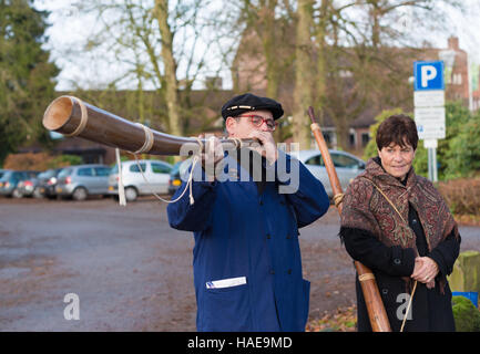 OLDENZAAL, NETHERLANDS - NOVEMBER 27, 2016: Unknown man blowing a so called 'midwinterhorn', a traditional handmade - Stock Photo