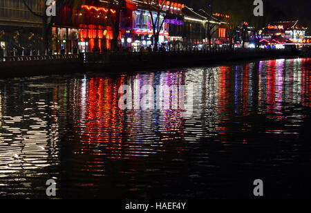 Beijing nightlife water reflections in Qianhai lake historical district - China - Stock Photo
