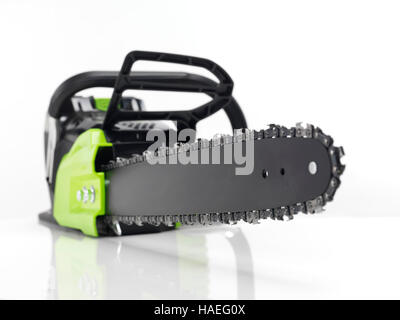 Electric Cordless battery powered chainsaw isolated on white - Stock Photo