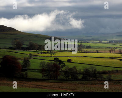 clouds and soft light over barn & fields near Orton in Cumbria UK looking towards the Yorkshire fells beyond Kirkby - Stock Photo