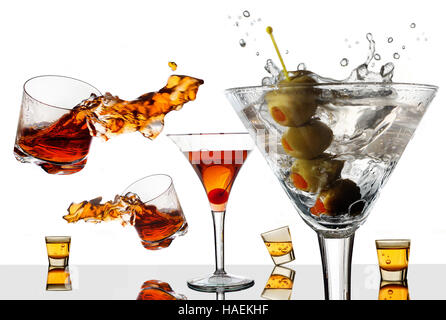 Old cocktails make a new splash. Traditional cocktails are seen splashing about in this photo illustration on a - Stock Photo
