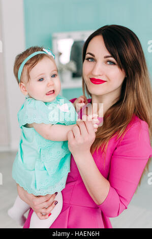 Mother and baby closeup portrait, happy faces, european family picture, adorable small girl, mom and kid having - Stock Photo