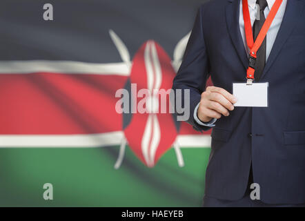 Businessman holding name card badge on a lanyard with a flag on background - Kenya - Stock Photo