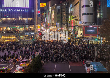 TOKYO, JAPAN - November, 22, 2014: Shibuya crossing in Tokyo, the busiest intersection in the world - Stock Photo