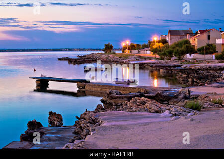 Island of Vir beach and waterfront at dawn, Dalmatia, Croatia - Stock Photo