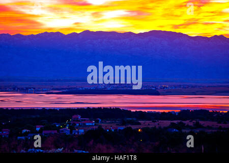 Vir and Pag islands at dawn, with Velebit mountain background, Dalmatia, Croatia - Stock Photo