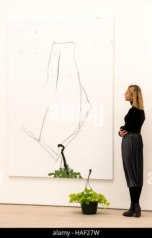 A visitor to the gallery looks at the painting Past, Present and Future (#1) by Richard Aldrich. Saatchi Gallery - Stock Photo