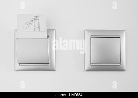 Hotel open room card system with light switch white wall. Horizontal - Stock Photo