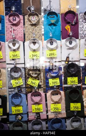 shirts on display with price list during diwali festival at mumbai maharashtra india - Stock Photo