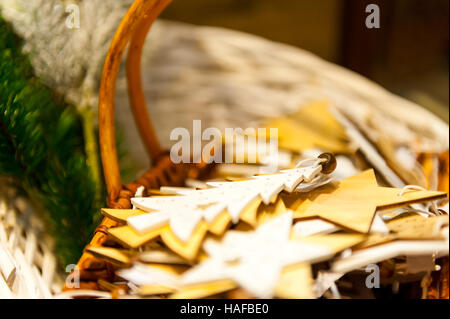 Christmas Fir Tree and stars Toys Old wooden in the basket Burning Candles, Boxes, Balls, Pine Cones, Walnuts, Branchesin - Stock Photo