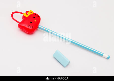 View of a pencil sharpener, an eraser and a pencil isolated on a white background. - Stock Photo
