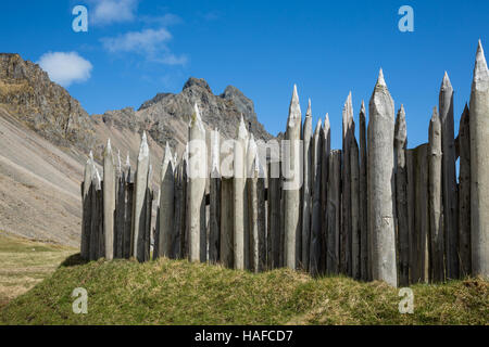 In a replica viking village, made for movie productions near Hofn, Iceland, this wood fence lined the outside of - Stock Photo