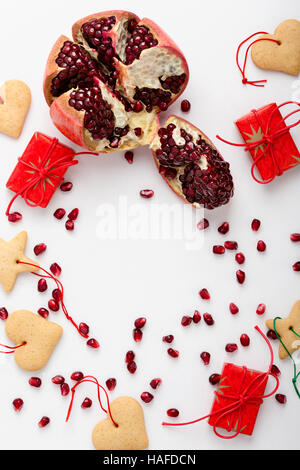 Frame of homemade christmas cookies, pomegranate seeds and gifts with copy spase for holiday text. Xmas handmade - Stock Photo